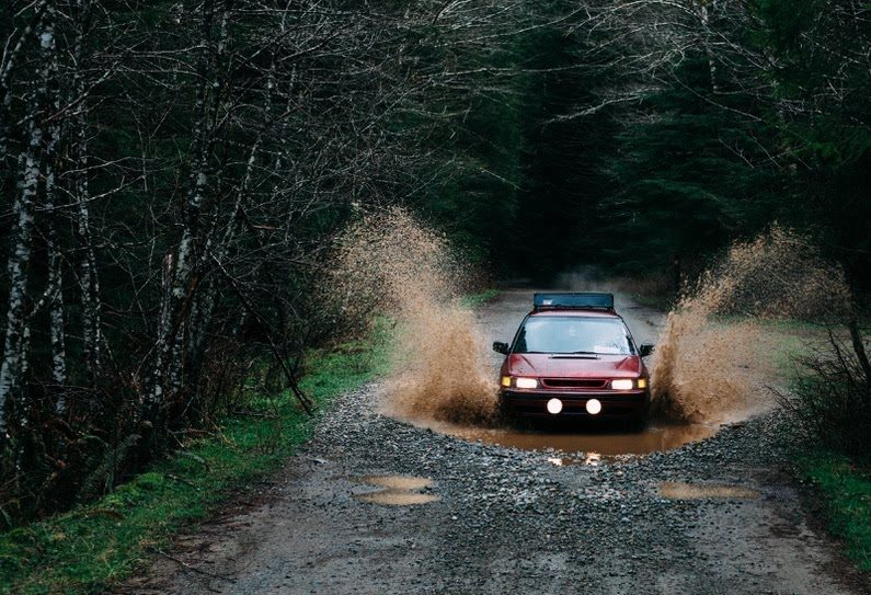 Lifted Subaru off road in the forest