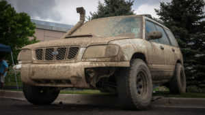Muddy subaru forester with all terrain tires