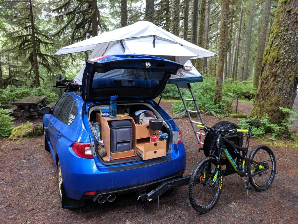 Lifted wrx hatchback with a roof top tent and camping set up