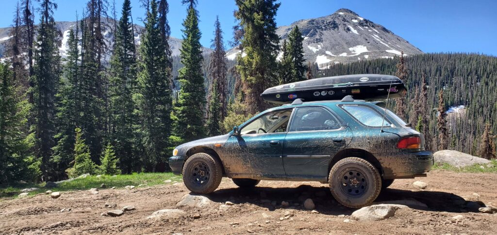 lifted subaru impreza with off road tires and roof rack 5