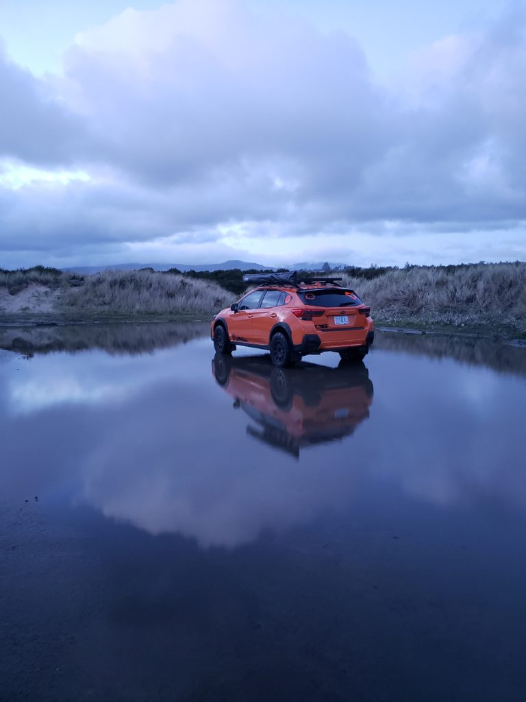 subaru crosstrek with lift kit and off road gear in the water