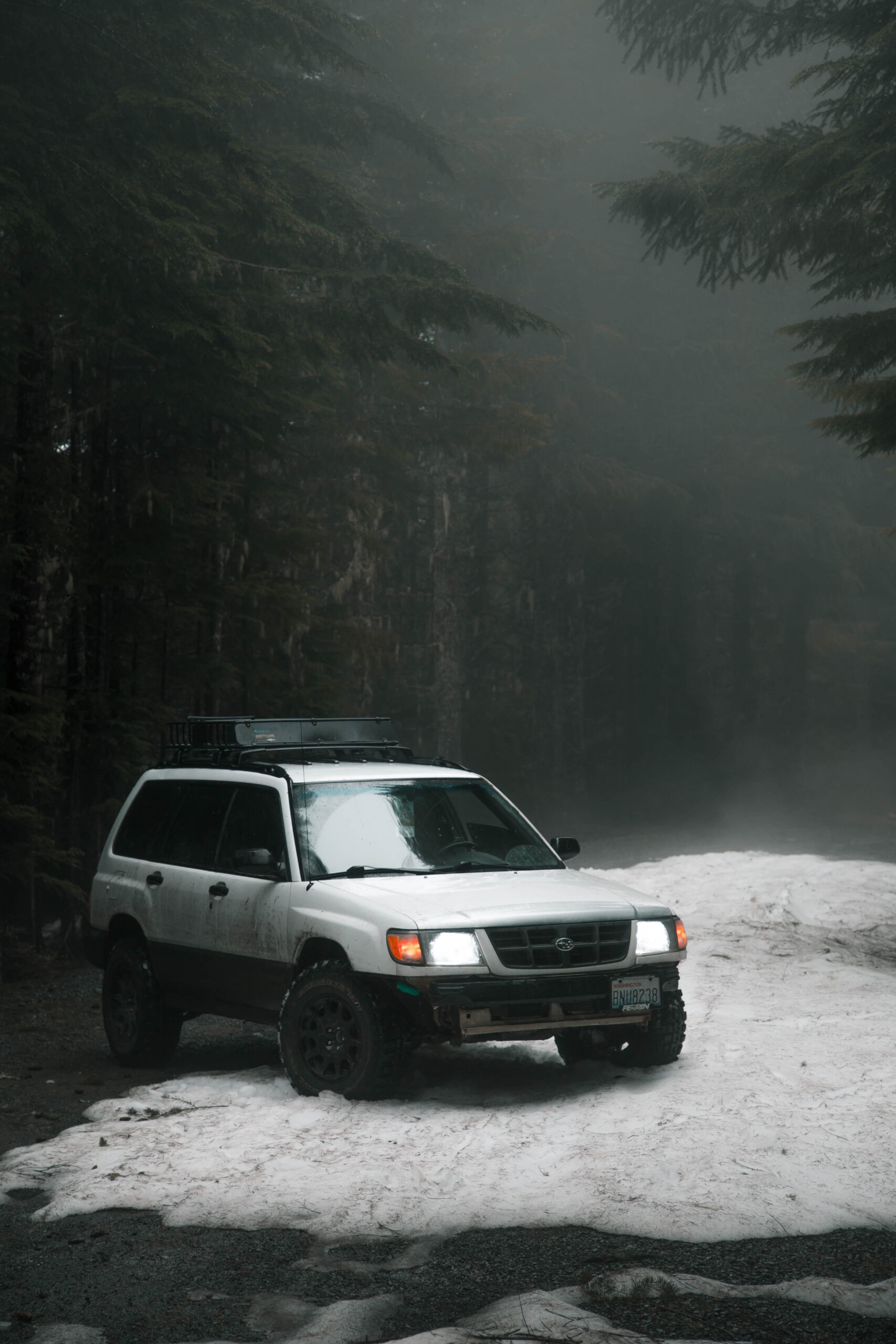 Lifted 2000 subaru forester with federal couragia mt tires in the snow on method wheels