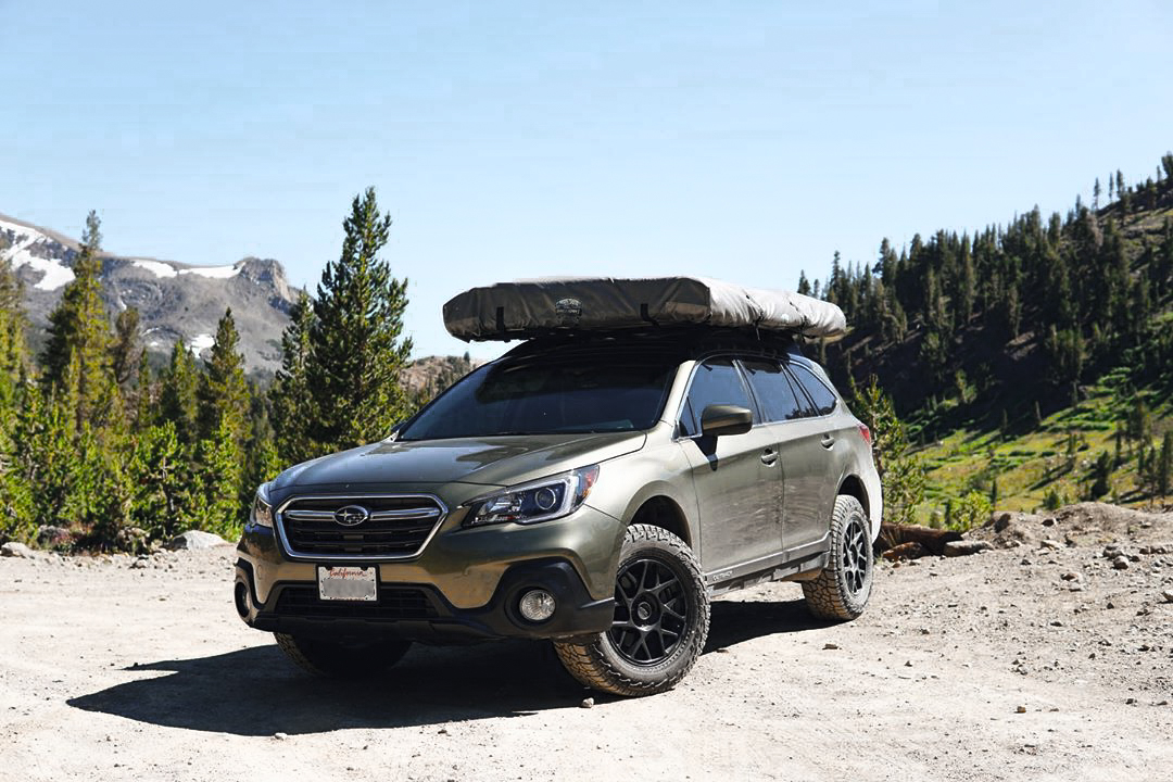 Lifted subaru outback with KMC Bully wheels and all terrain tires