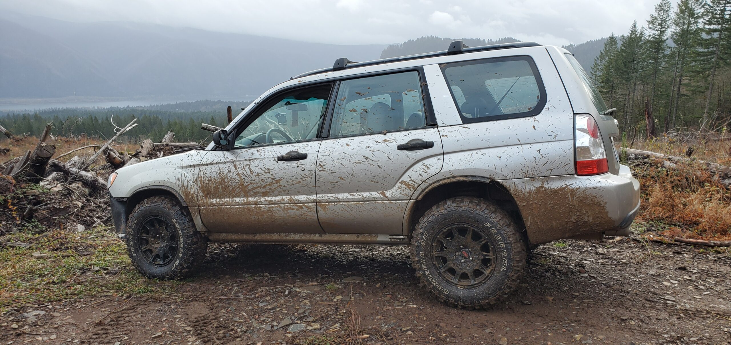 lifted subaru forester with mud tires and fender flares