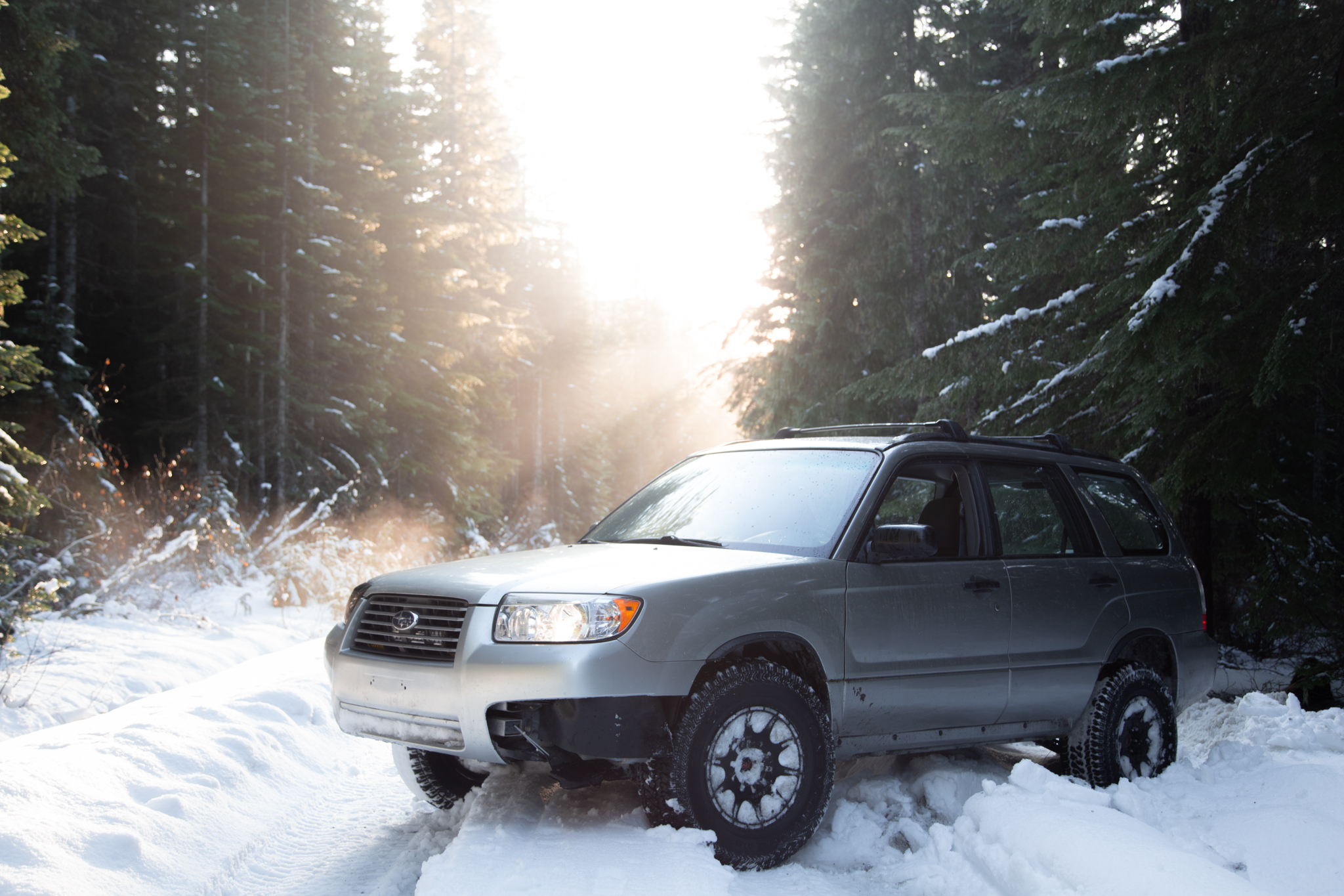 lifted subaru forester with all terrain tires and method mr502 wheels