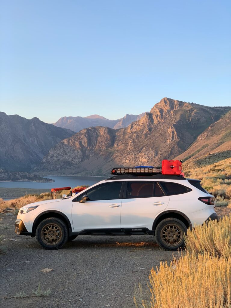 lifted 2020 subaru outback xt with off road tires and a rotopax gas can