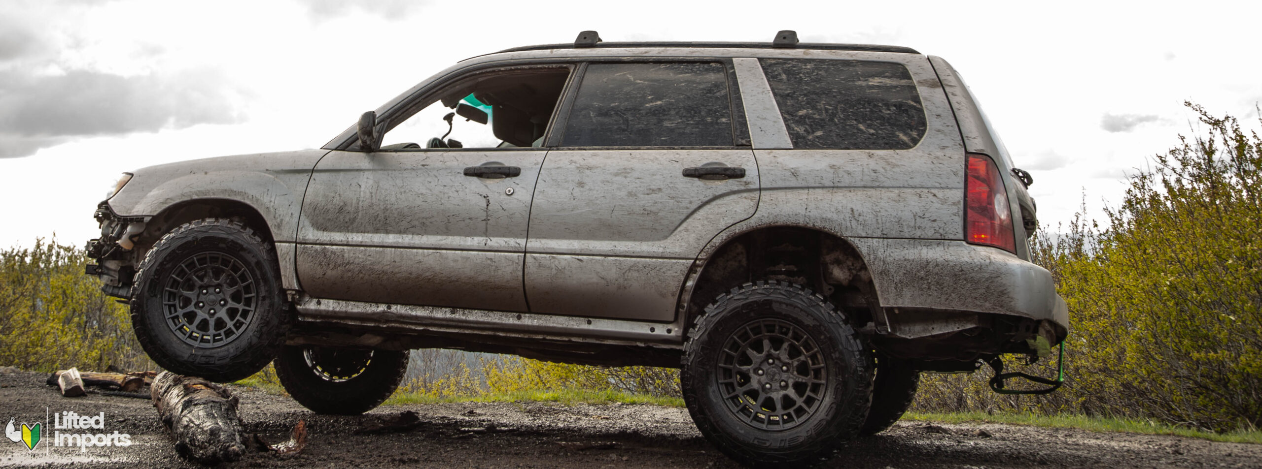 lifted subaru forester with mud terrain tires and lift kit