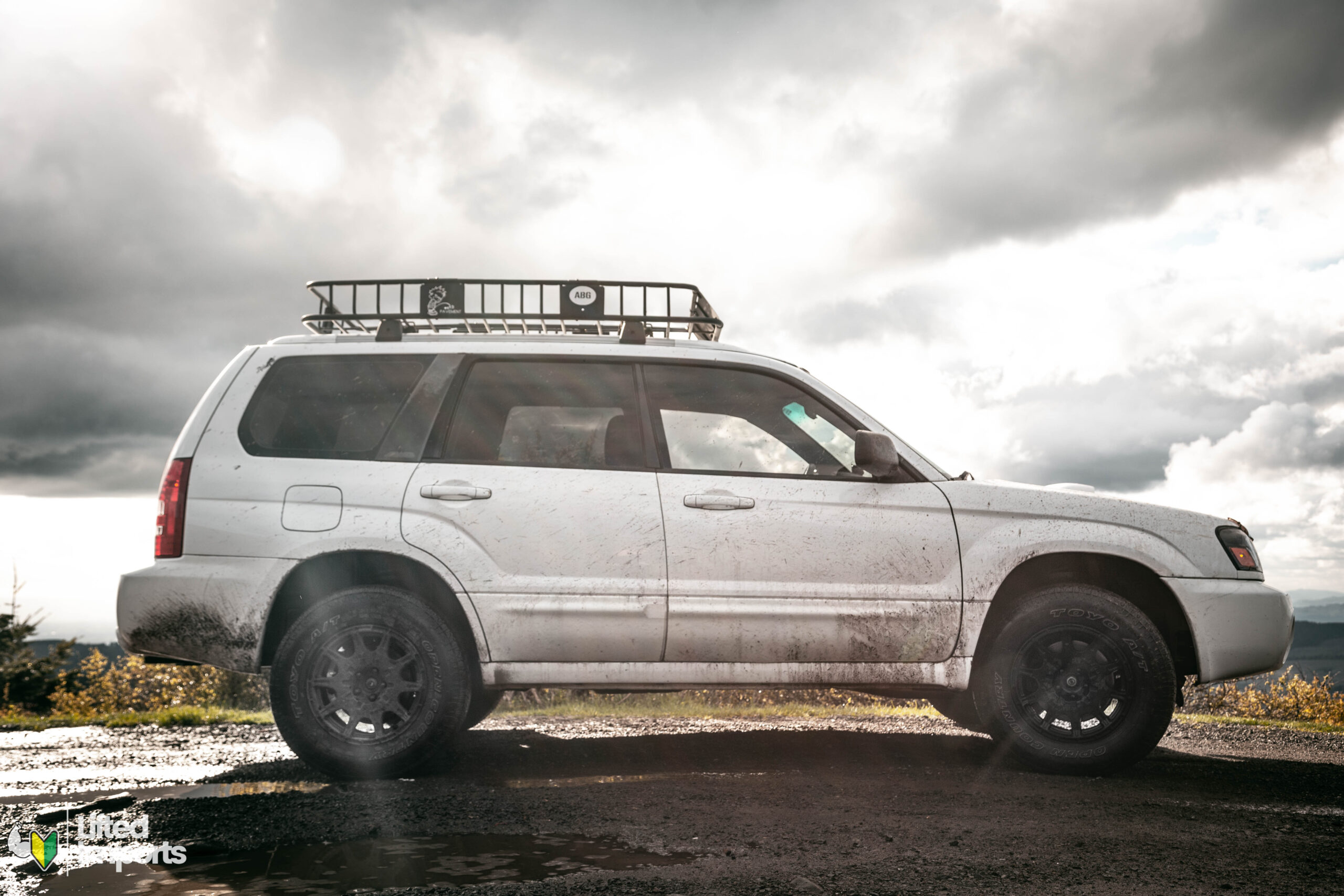 Lifted Subaru forester xt with off road tires and method mr502 wheels