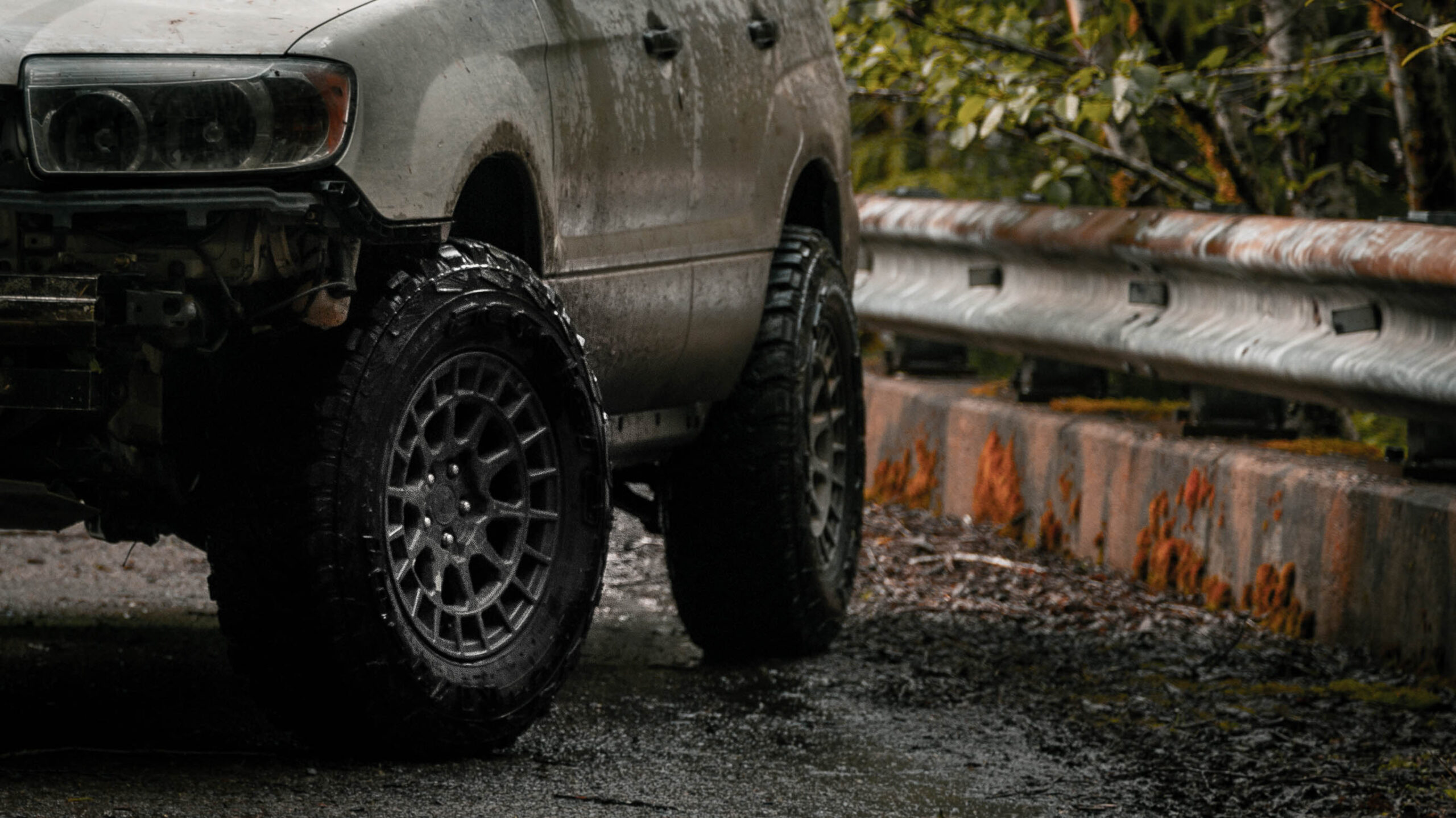 lifted subaru with black rhino boxer wheels and Accelera MT01 tires