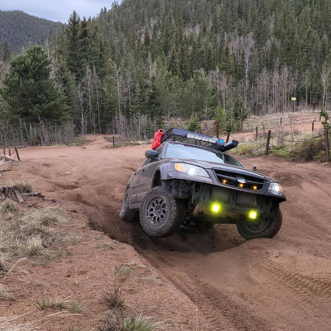 lifted 2008 subaru outback with bfg ko2 off road tires and rotopax