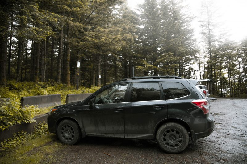 lifted subaru forester with all terrain big tires on a lift kit